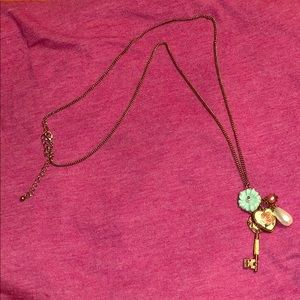 Jewelry - Long, gold necklace with several charms!